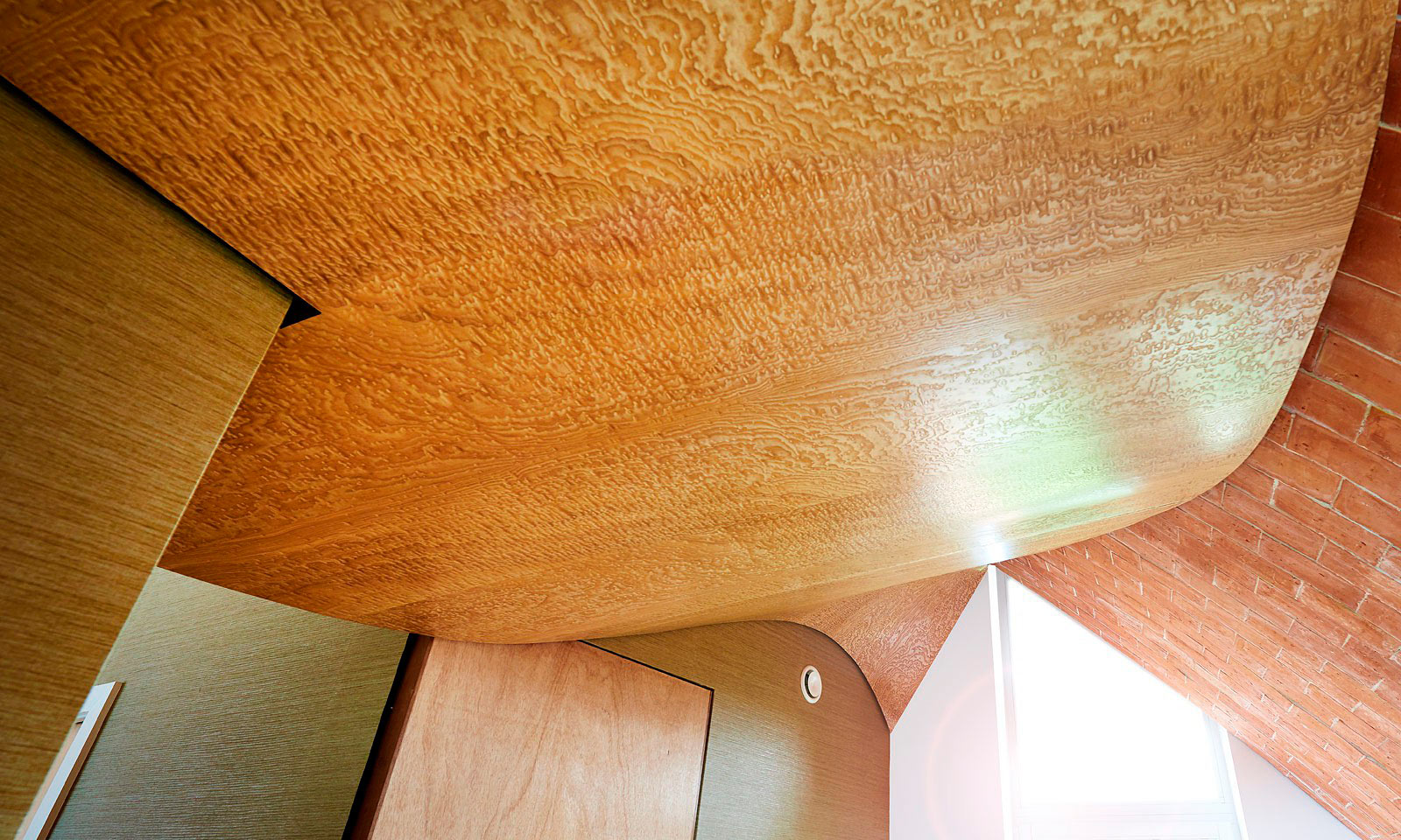 Verity's ceiling. A bespoke hand-crafted, timber ceiling, designed for Crossway, Hawkes Architect's para 55 eco-house. Featured on Grand Designs this unique stucture was manufactured from veneered Japanese birds eye ash and installed by the skilled joiners from Mounts Hill Woodcraf