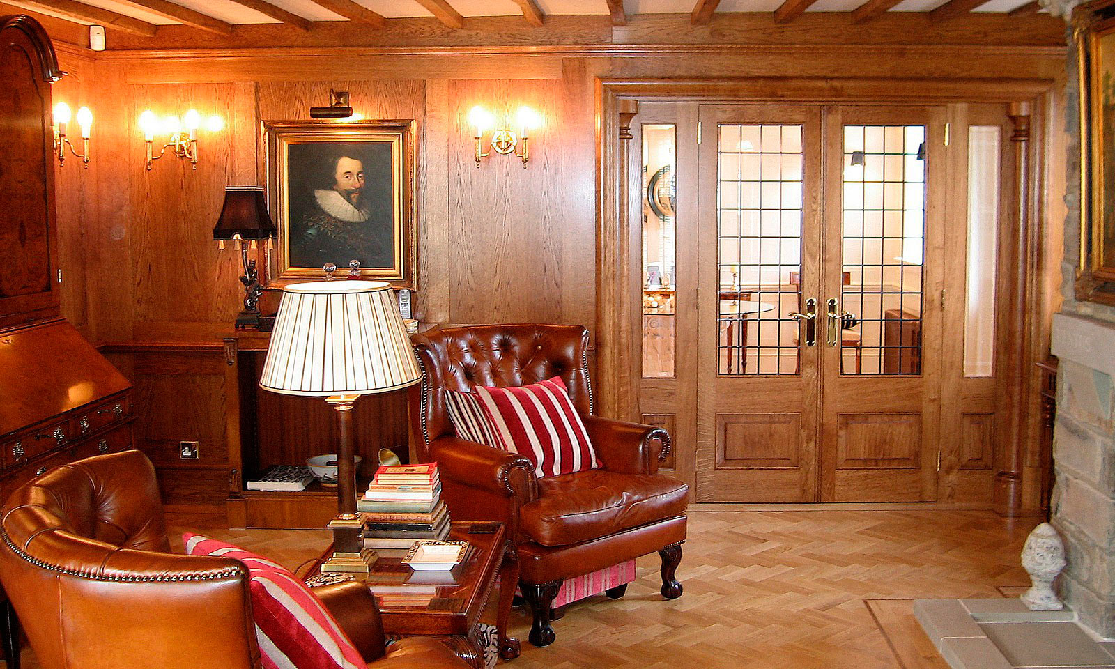 Oak panelled drawing room. Bespoke, custom made, traditional hardwood panelling, pediments, architraves and balusters, manufactured and installed by the skilled joiners at Mounts Hill Woodcraft.