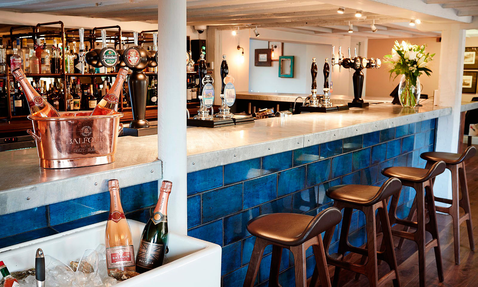 The Tickled Trout. Our commercial refurbishment for Hush Heath Hospitality. Commissioned to manufacture a bespoke, custom made, galvanised bar and copper drinks display, modelled around a traditional fishmongers. A bespoke design, installed by the skilled joiners at Mounts Hill Woodcraft.