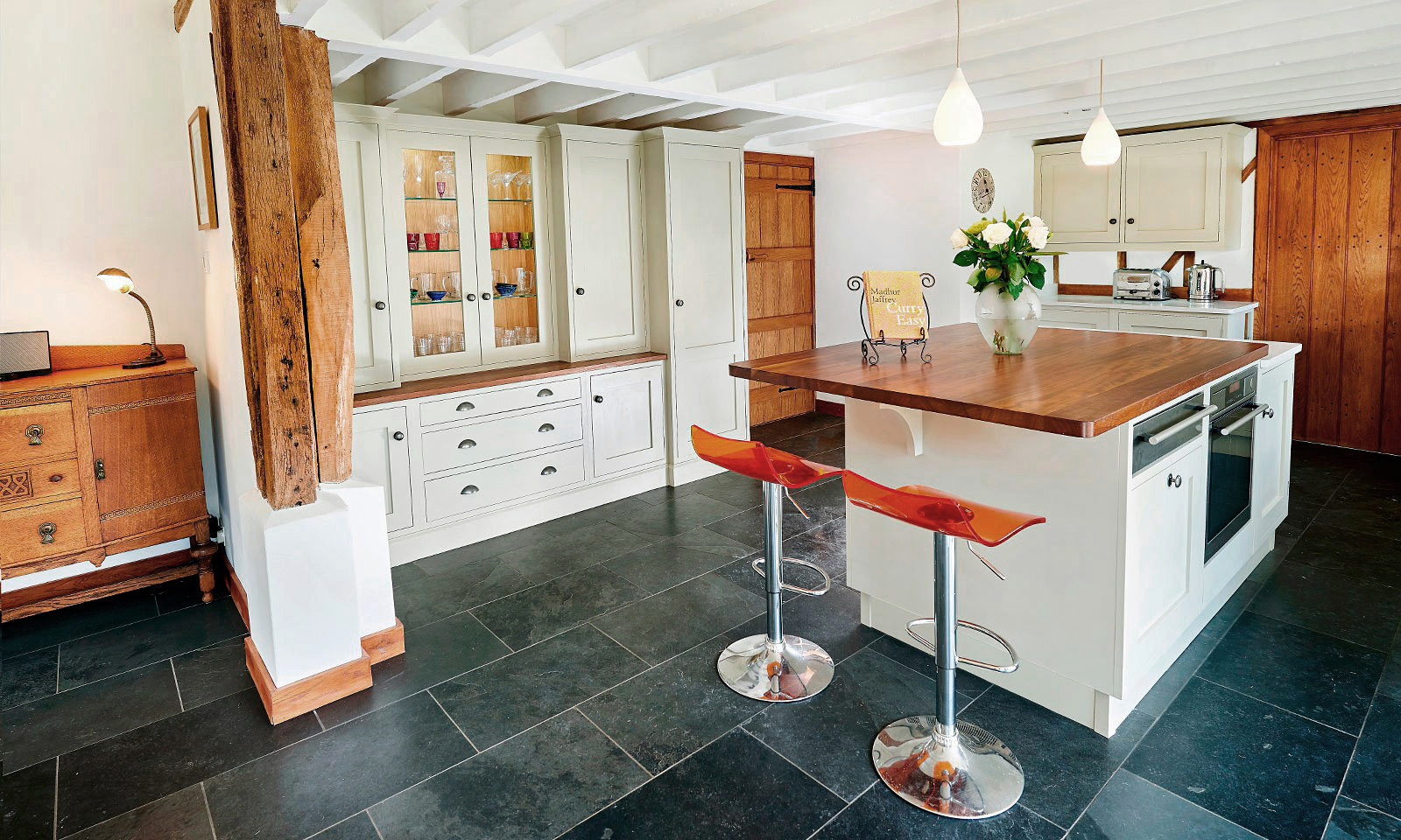 Golford. A classic handmade, hand-painted, Shaker style kitchen, installed in a large barn. A bespoke hand-crafted kitchen manufactured by the skilled cabinet makers at Mounts Hill Woodcraft.