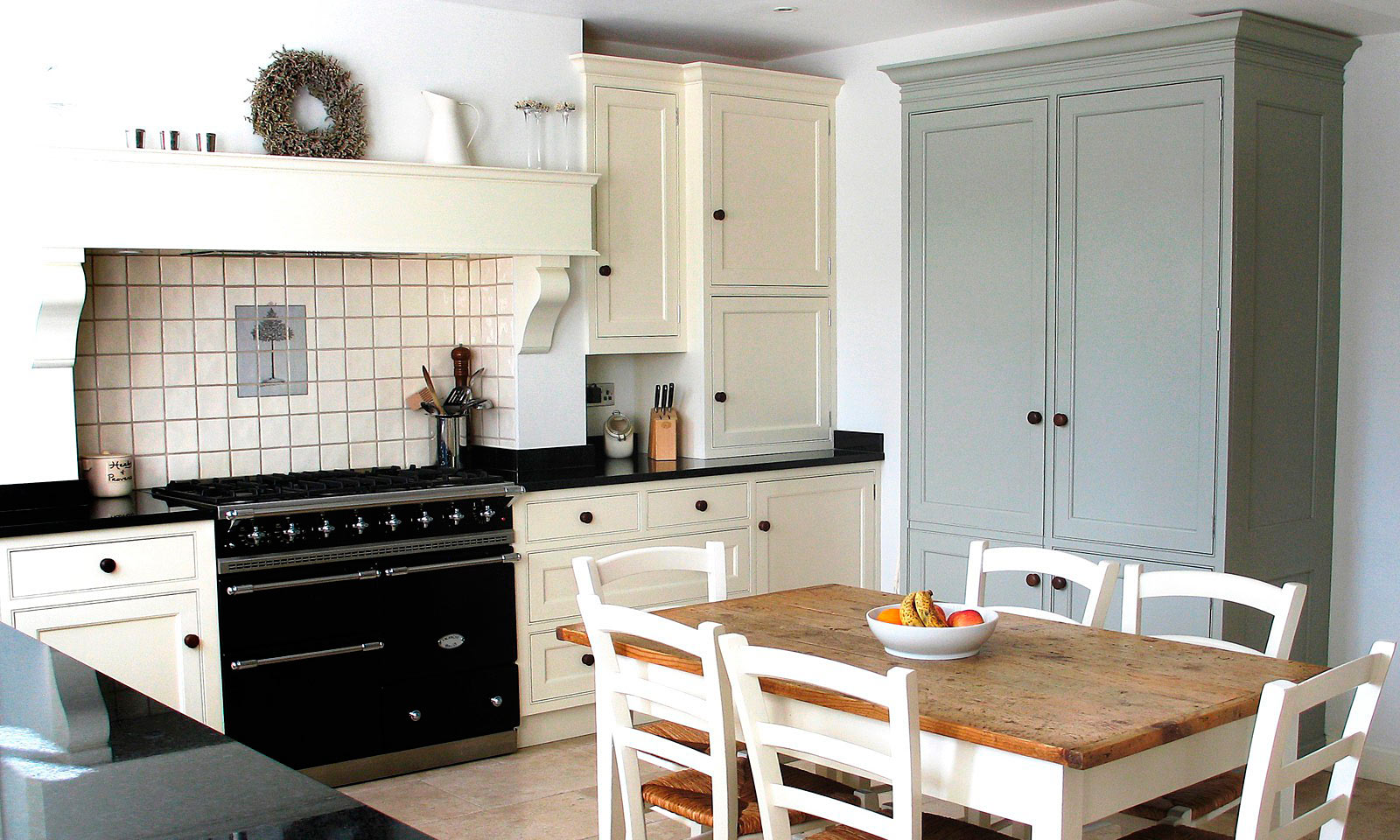 Otford. A classic handmade, hand-painted, Shaker style kitchen, installed in a traditional farmhouse and featuring a built in Bang & Olufsen music system. A bespoke hand-crafted kitchen manufactured by the skilled cabinet makers at Mounts Hill Woodcraft.