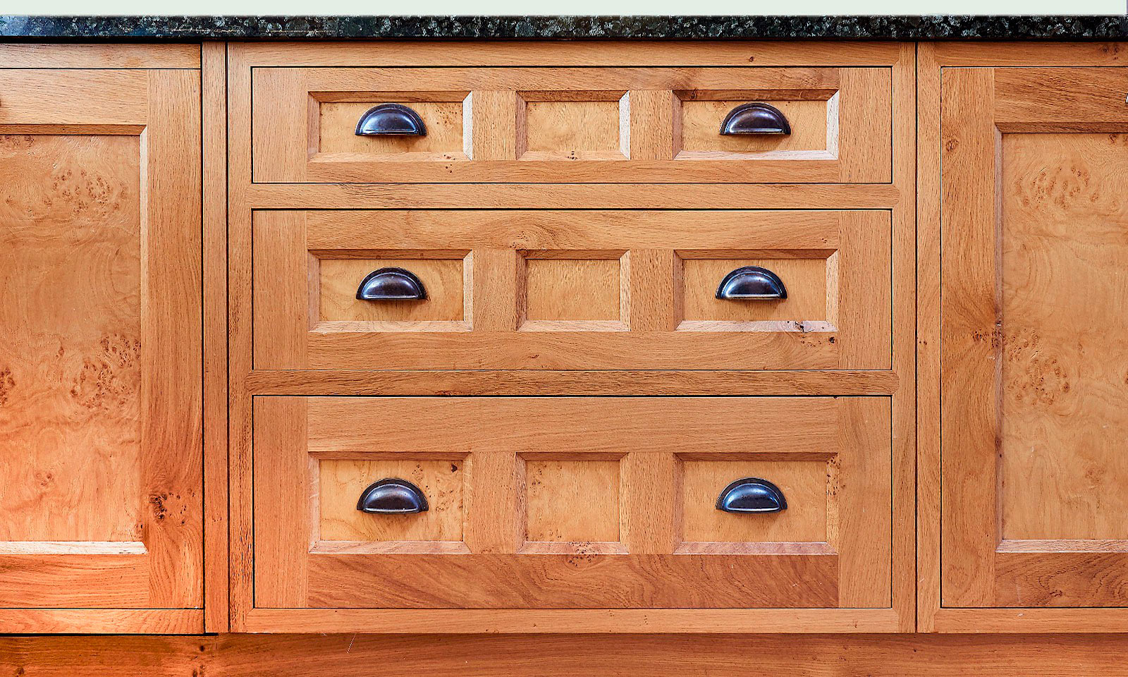 Pantiles. A classic handmade, hand-painted, Shaker kitchen, installed in a grade II listed building. Built using solid European oak and finished in cluster oak veneer with granite worktops. Another hand-crafted kitchen manufactured by the skilled cabinet makers at Mounts Hill.
