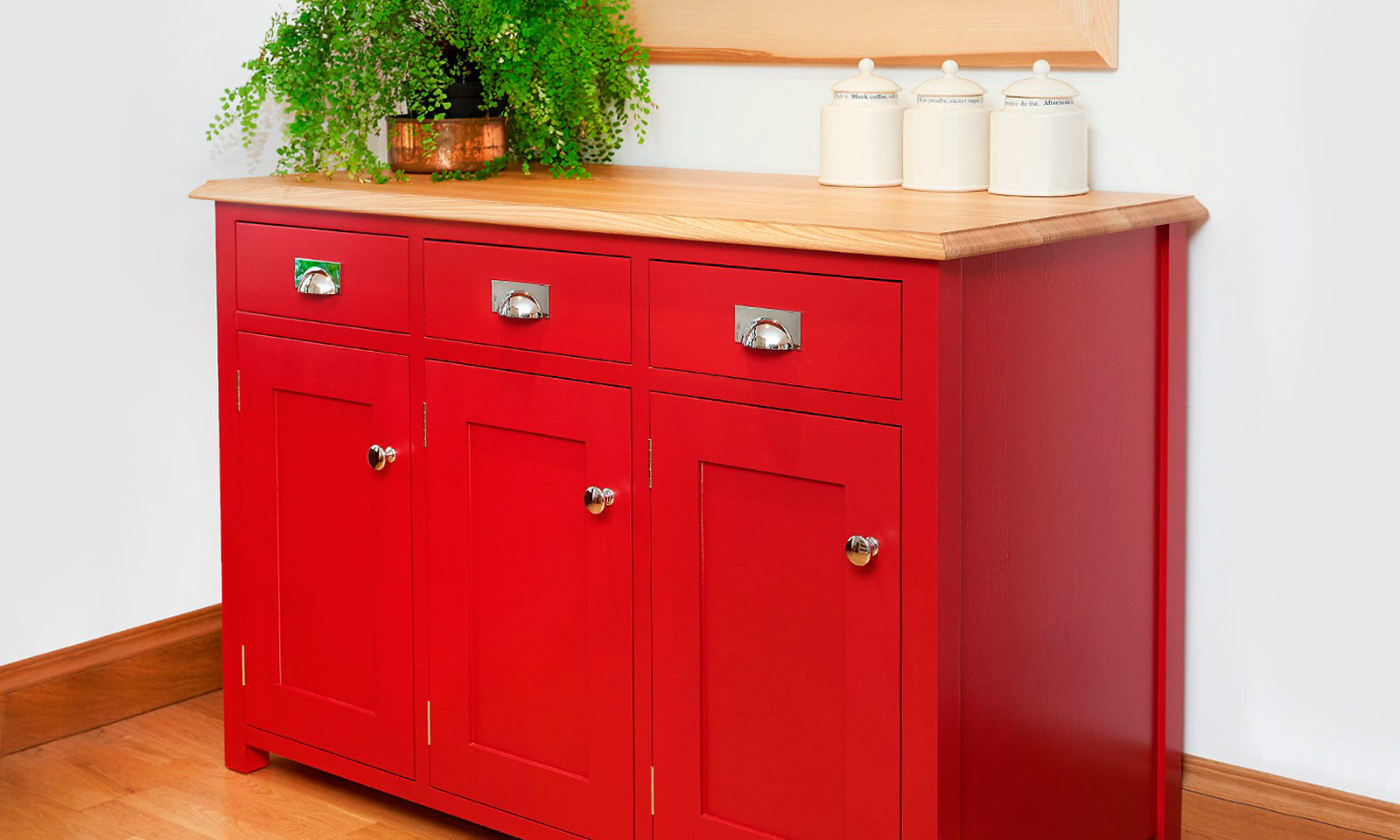 Scarlet Dresser. A bespoke, handmade, hand-painted traditional red dresser, for inclusion in a classic shaker style kitchen. Manufactured with an ash top and bright polished chrome cup handles, another future antique from Mounts Hill.